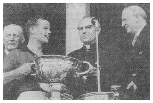 Down captain Kevin Mussen receives the Sam Maguire cup from President Eamon Devalera in 1960.
