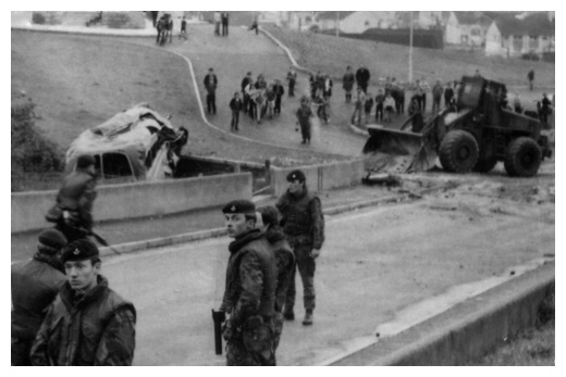 The British Army dismantle a barricade in Derrybeg in the seventies.