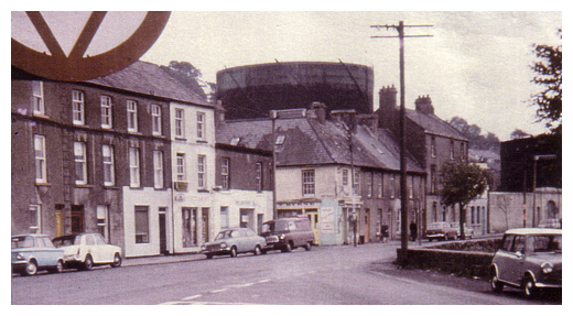 Kilmorey street in Newry with large gasometer in the background.