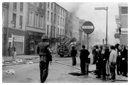 Newry people survey the damage in the town centre on the morning of Internment when many Civil Rights activists were taken from their homes.