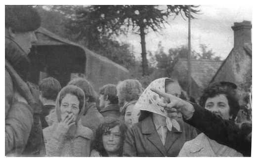 Newry women castigate British soldiers at the UDR centre, while at rear internees prepare to board an army lorry en route to Long Kesh or the Prison Ship Maidstone.