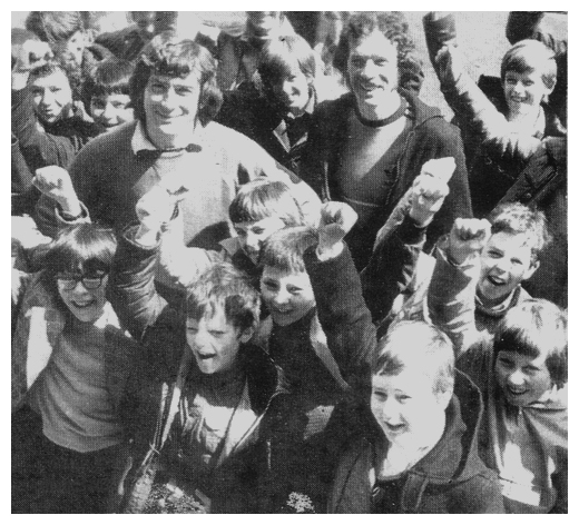 Pat Jennings and his brother Brian, former sportsmaster at St Paul's High School with pupils at Whitehart Lane.